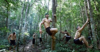 MovNat practitioners climbing trees and moving in nature